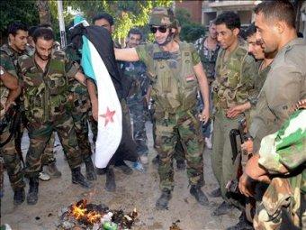 Soldats syriens brûlant le drapeau des amis de François Hollande