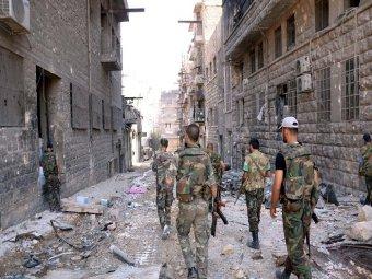 Armée syrienne dans les rues de Homs