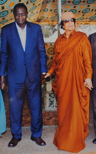 Malik Obama et Mouammar Kadhafi