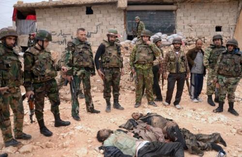 Armée syrienne observant des terroristes tués