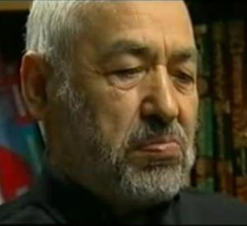 Rached Ghannouchi regardant la photo d'Amina