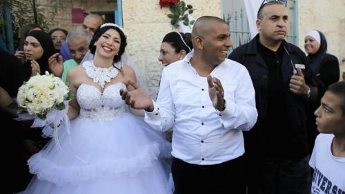 Le marié Mahmoud Mansour et son épouse Maral Mal-ka.